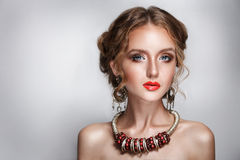 Blond hair beauty woman portrait wears golden ear-rings and necklace Royalty Free Stock Images