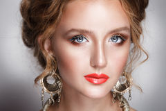 Blond hair beauty woman portrait wears golden ear-rings and necklace Royalty Free Stock Photos