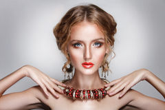 Blond hair beauty woman portrait wears golden ear-rings and necklace Stock Photography