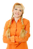 Blond hair and blue eyes girl in orange blouse and cap folds arms Royalty Free Stock Photos
