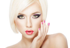 Blond hair girl. Beautiful woman with short Blond hair, bright violet purple makeup, lips and manicure Royalty Free Stock Photos