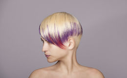 Blond hair girl with violet paint. Beautiful Woman Stock Images