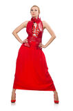The blond hair model in dress with pomegranate  on white Royalty Free Stock Images