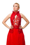 The blond hair model in dress with pomegranate  on white Royalty Free Stock Photo