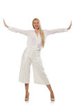 Blond hair model in elegant flared pants isolated on white Royalty Free Stock Image