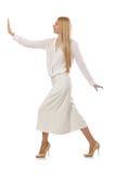 The blond hair model in elegant flared pants  on white Stock Photos