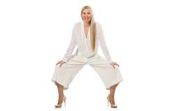The blond hair model in elegant flared pants  on white Stock Image