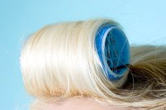 Blond hair in a roller royalty free stock photos