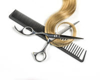 Blond hair and scissors Stock Photos