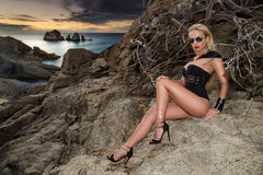 Blond hair sexy woman young girl model in sunglasses and elegant black and gold sexy swimsuit lingerie Royalty Free Stock Photography