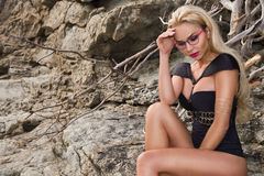 Blond hair sexy woman young girl model in sunglasses and elegant black swimsuit. Beautiful blond hair sexy woman young girl model in sunglasses and elegant black Stock Image