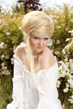 Blond hair style. Beautiful woman on nature Stock Images