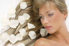 Blond hair white petals Royalty Free Stock Photo