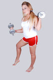Blond hair woman with dumbbells. Stock Image