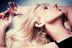 Blond hair woman lie portrait Stock Photo