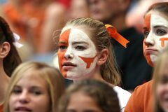 Blond Hair Woman With Orange and White Face Paint Royalty Free Stock Photo