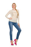 The blond hair woman posing in blue jeans isolated on white Royalty Free Stock Photo