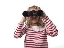 Blond hair young little girl looking holding binoculars looking Royalty Free Stock Photo