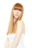 Blond hair. Young woman with long, straight hair Royalty Free Stock Photography