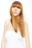 Blond hair. Young woman with long, straight hair in wind Royalty Free Stock Photos