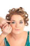 Blond hairdo and makeup in progress Royalty Free Stock Image