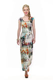 Blond haired business woman in summer  floral long dress Royalty Free Stock Photography