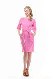 Blond haired business woman in summer pink dress Stock Image