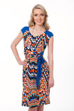 Blond haired business woman in summer print dress Royalty Free Stock Photo