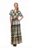 Blond haired business woman in summer print long dress Stock Image