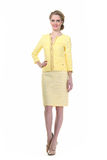Blond haired business woman in summer  yellow suit Stock Photography