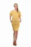 Blond haired business woman in summer yellow suit Stock Images