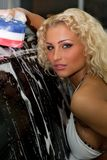 Blond haired car wash girl Royalty Free Stock Photography