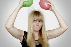 Blond haired girl with electric loaded balloons Royalty Free Stock Photos