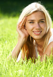 Blond haired teen on field stock photos