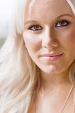Blond haired woman. Portrait of attractive blond haired woman outdoors Stock Photos