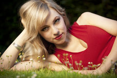 Blond haired woman on grass Royalty Free Stock Image