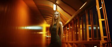 Blond haired woman in indoor portrait Stock Photography