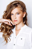 Blond-haired 13-years old girl in studio Royalty Free Stock Photo