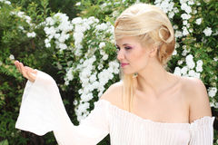 Blond hairstyle beautiful woman. Banner, holding Stock Photos