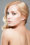 Blond with hairstyle and makeup Royalty Free Stock Images