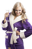 Blond haooy girl in bathrobe drinking champagne Royalty Free Stock Photography