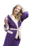 Blond haooy girl in bathrobe drinking champagne Stock Photo