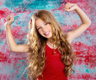 Blond happy children girl in red happy arms up Royalty Free Stock Photos