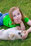 Blond happy girl with her chihuahua doggy portrait Royalty Free Stock Photography