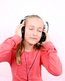 Blond happy girl listening to music with headset Royalty Free Stock Photo