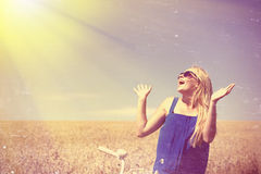 Blond happy girl wearing sunglasses excited with Royalty Free Stock Photo