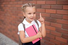 Blond happy smiling little girl excited laugh hands in mouth. royalty free stock images