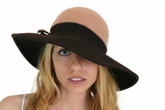 Blond in Hat. Blond peaks through Hat Stock Photo