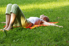 Blond have rest. Young blonde woman have rest in park laying down Stock Image
