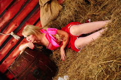 Blond in the hayloft Stock Photos